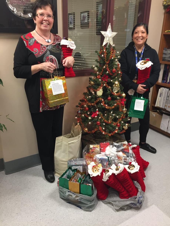 Gifts delivered by Santa's helper – Karen Langer